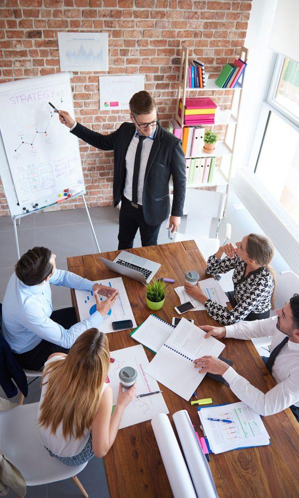 high-angle-view-on-business-meeting-8QP4BU2.jpg